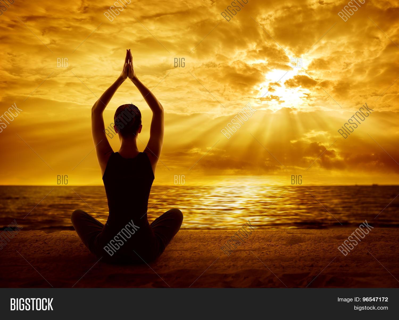 Yoga Meditation Concept Woman Silhouette Meditating In Healthy Pose Sun Light Rays