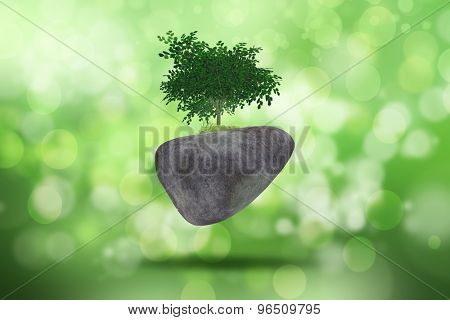 3D background with a tree on rock against a defocussed background
