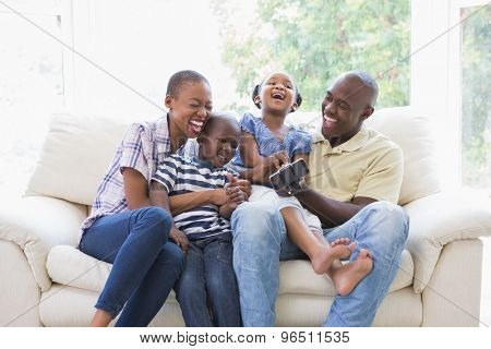 Happy smiling family on the couch in the living room