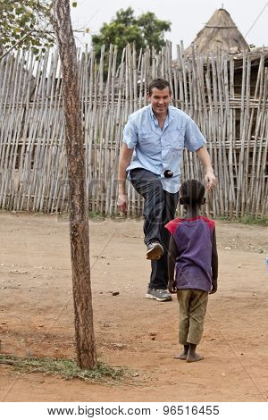 missionary playing with child in africa