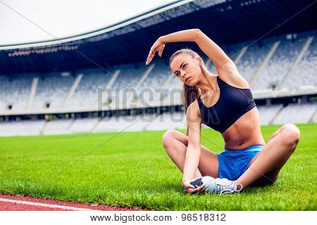 Fitness woman on stadium stretching