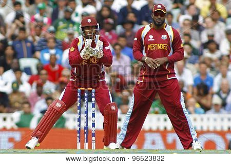 LONDON, ENGLAND - June 07 2013: West Indies Denesh Ramdin and Chris Gayle during the ICC Champions Trophy cricket match between Pakistan and The West Indies at The Oval Cricket Ground.