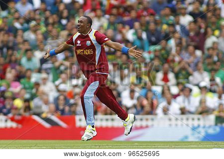 LONDON, ENGLAND - June 07 2013: West Indies Dwayne Bravo celebrates a wicket, during the ICC Champions Trophy cricket match between Pakistan and The West Indies at The Oval Cricket Ground.