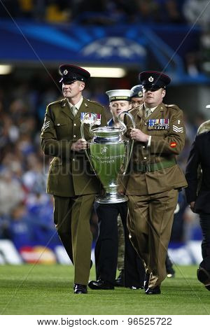 LONDON, ENGLAND. September 19 2012 Members of Her Majesty's armed forces parade the Champions League trophy prior to the UEFA Champions League football match between Chelsea and Juventus