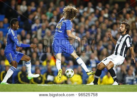LONDON, ENGLAND. September 19 2012 Chelsea's defender David Luiz and Juventus's Italian midfielder Andrea Pirlo in action during the UEFA Champions League football match between Chelsea and Juventus