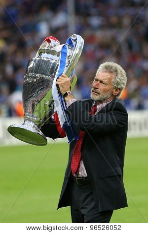 MUNICH, GERMANY May 19 2012. Paul Breitner, former Bayern Muenchen player presents the trophy for the 2012 UEFA Champions League Final at the Allianz Arena Munich