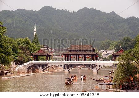 Tourists Relax,Take A Boat Trip On The River In Fenghuang Ancient City.
