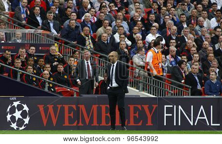 LONDON, ENGLAND. May 28 2011: Manchester's manager Sir Alex Ferguson and Barcelona's manager Josep Guardiola during the 2011UEFA Champions League final between Manchester United and FC Barcelona