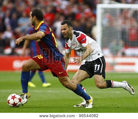 LONDON, ENGLAND. May 28 2011: Barcelona's midfielder Javier Mascherano and Manchester's midfielder Ryan Giggs during the 2011UEFA Champions League final between Manchester United and FC Barcelona