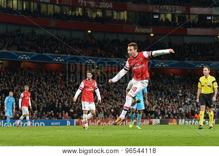 LONDON, ENGLAND - Nov 26 2013: Arsenal's Santi Cazorla takes a shot at goal during the UEFA Champions League match between Arsenal and Olympique de Marseille, at The Emirates Stadium