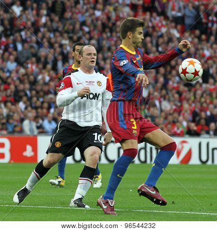 LONDON, ENGLAND. May 28 2011: Manchester's forward Wayne Rooney and Barcelona's defender Gerard Pique during the 2011UEFA Champions League final between Manchester United and FC Barcelona