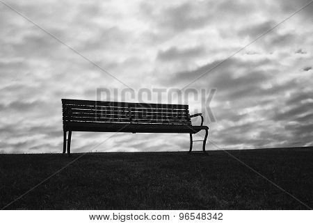 Bench With Ominous Sky