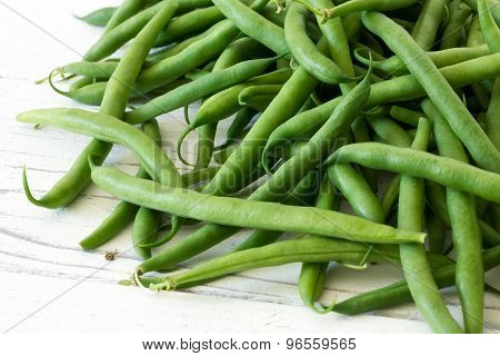 Green string beans on white.