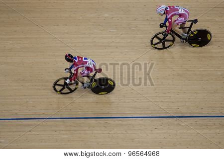 LONDON, ENGLAND. FEBRUARY 18 2012: Victoria Pendleton (GBR) and Jess Varnish (GBR) in action at the UCI Track Cycling World Cup at the London Velodrome, Queen Elizabeth 2nd Park