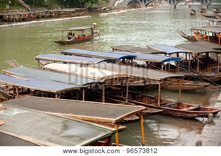 Tourists boats On The River In Fenghuang Ancient City.