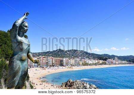 LLORET DE MAR, SPAIN - MAY 22: A panoramic view of Platja de Lloret beach on May 22, 2015 in Lloret de Mar, Spain. It is the main beach in this popular tourist village in the Costa Brava, in Catalonia