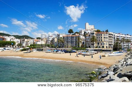 SANT POL, SPAIN - MAY 23: A view of Platja de les Barques beach and the Ermita de Sant Pau in the top of the hill on May 23, 2015 in Sant Pol, Spain. Boats, barques in Catalan, give name to this beach