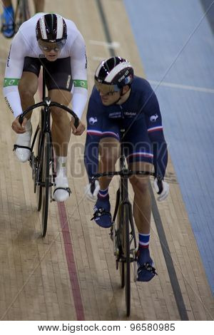 LONDON, ENGLAND. FEBRUARY 18 2012: Matthew Glaetzer (AUS) and Mickael Bourgain (FRA) in action at the UCI Track Cycling World Cup at the London Velodrome, Queen Elizabeth 2nd Park