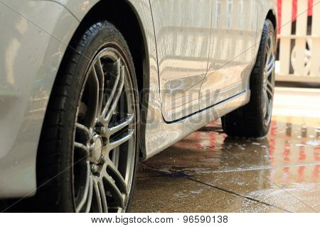 Car Wash With Water And Foam Cleaning