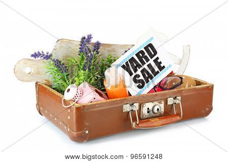 Old suitcase of unwanted stuff ready for yard sale isolated on white