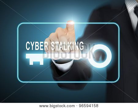 Male Hand Pressing Cyber Stalking Key Button