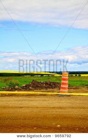 Orange Cone On A Dirt Road
