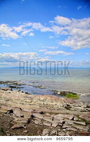 Large River Scenery With Blue Moutains And Rocks.