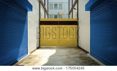 Yellow door with warehouse closeup photo stock