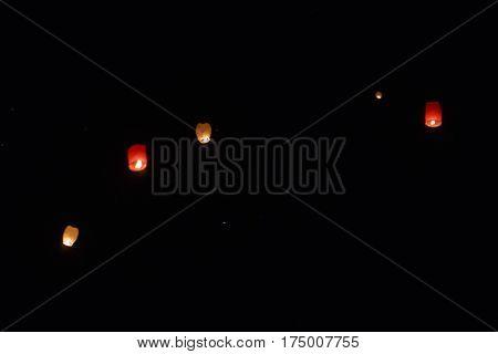 Sky lanterns flying above the beautiful city of Avila