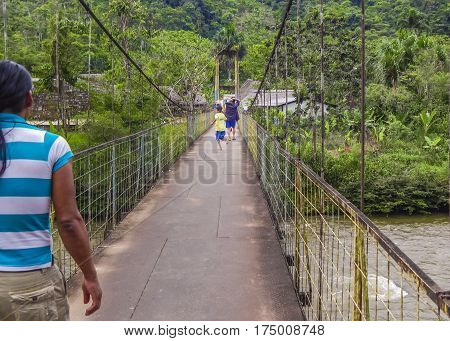 PUYO, ECUADOR, OCTOBER - 2015 - Children running at bridge at ecuadorian side of amazonia in Puyo district Ecuador