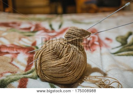 To Knit Spokes. A Ball Of Woolen Threads And A Spoke For Knitting.