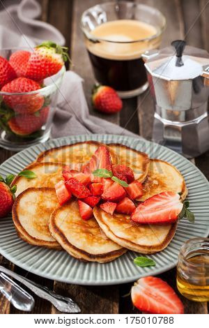 Homemade Delicious Pancakes Served With Fresh Strawberries And Honey