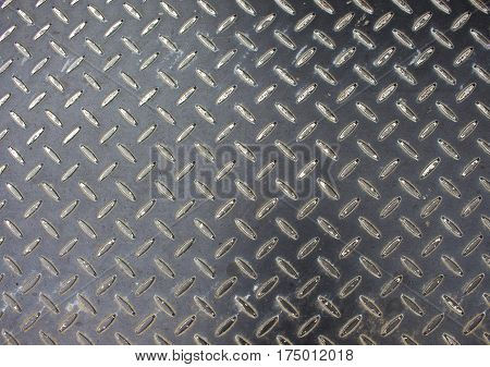 Iron floor surface photo. Metal relief for walking path in construction area. Rustic metallic blocks on road. Grey iron floor tile. Stainless plate standard ornament. Monochrome industrial background