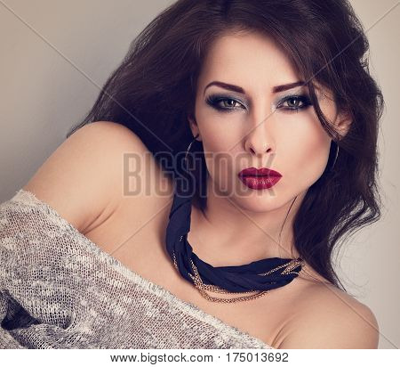 Beautiful Expressive Make-up Woman With Red Lips Posing In With Modern Necklace On The Neck. Long La