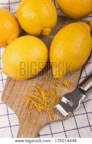 fresh lemon zest on a wooden board