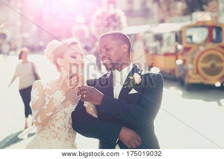 Happy African American Groom And Cute Bride Walking On Street