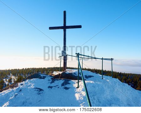 Winter Mountain. Wooden Cross On Rocky Mountain Summit.