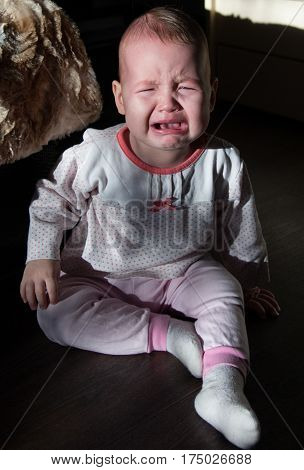 Portrait of a crying baby. The baby cries