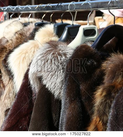Fur Coats And Clothes For Sale In The Hanger In The Local Market