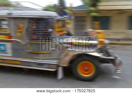 Panning photograph of a Jeepney. Jeepneys are popular public transportation in the Philippines and they are originally made from U.S. military jeeps.