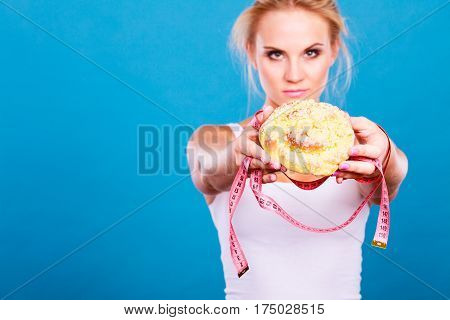 Woman Holds Sweet Bun Recommending Non Sugar Diet