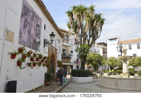 MARBELLA, SPAIN - FEBRUARY 27, 2017: Fountain in plaza of the historic center of Marbella a city of the province of Malaga Andalusia Spain.