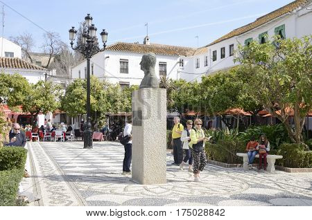 MARBELLA, SPAIN - FEBRUARY 27, 2017: People at the animated plaza of the Orange Tree in the historic center of Marbella a city of the province of Malaga Andalusia Spain.