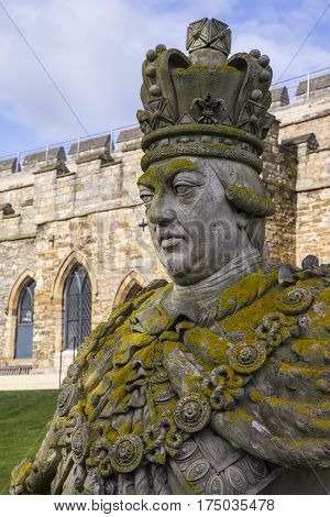 A statue or bust of King George III in the grounds of the historic Lincoln Castle in the city of Lincoln UK.