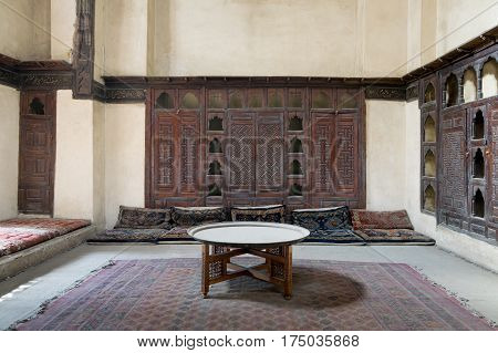 Cairo, Egypt - November 19, 2016: Room at El Sehemy house, an old Ottoman era house in Cairo, built in 1648. with built-in couch, and embedded wooden cupboard