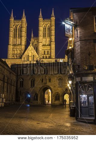 LINCOLN UK - FEBRUARY 27TH 2017: A view of the magnificent Lincoln Cathedral with Exchequer Gate and the Magna Carta public house in the foreground in Lincoln UK, on 27th February 2017.