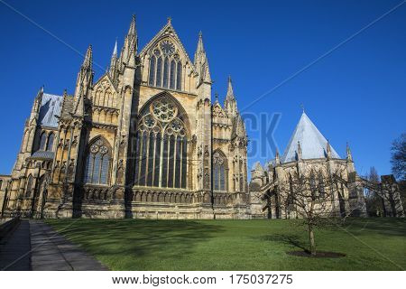 A view of the eastern facade of Lincoln Cathedral and the Chapter House in the historic city of Lincoln UK.