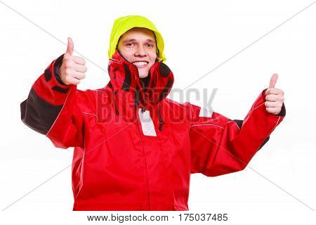Hooded man in waterproof jacket. Young male man in protective clothing. Adventure danger concept.