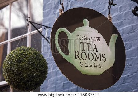 LINCOLN UK - FEBRUARY 28TH 2017: A sign for The Steep Hill Tea Rooms and Chocolatier in the historic city of Lincoln in the UK on 28th February 2017.