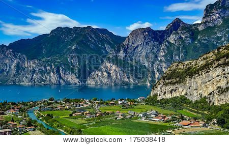 Panorama of the gorgeous Lake Garda surrounded by mountains in Riva del Garda Italy. Lake Garda Italy